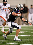 TCU Horned Frogs quarterback Andy Dalton #14 running with the ball during the game between the Oregon State Beavers and the TCU Horned Frogs at the Cowboy Stadium in Arlington,Texas. TCU defeated Oregon State 30-21.