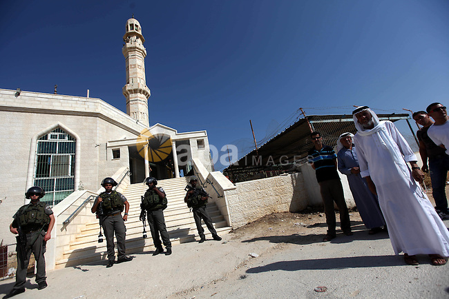 Israeli border police officers stand outside a damaged mosque in West Bank village of Jaba near Ramallah June 19, 2012. The mosque in the occupied West Bank was vandalised and set on fire early on Tuesday, in an attack Palestinians blamed on Israeli settlers. Photo by Issam Rimawi