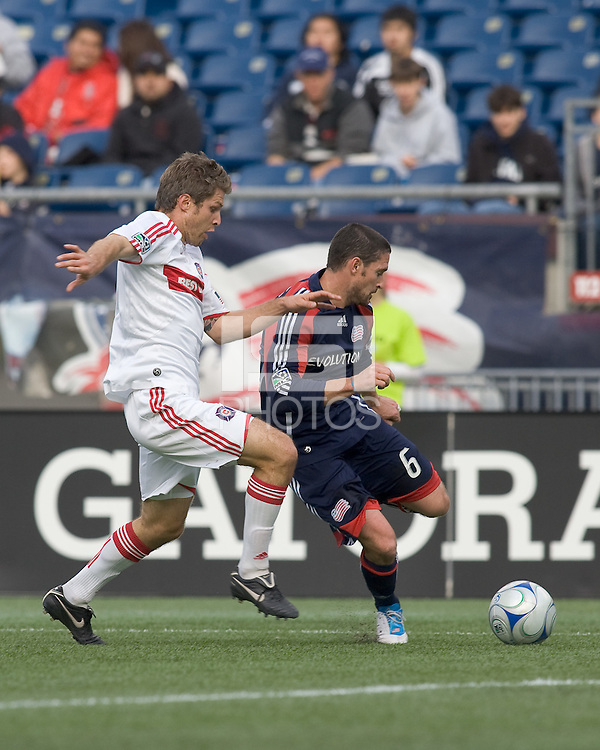 New England Revolution defender Jay Heaps (6) dribbles as Chicago Fire midfielder Logan Pause (7) defends. The New England Revolution out scored the Chicago Fire, 2-1, in Game 1 of the Eastern Conference Semifinal Series at Gillette Stadium on November 1, 2009.