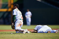 Mesa Solar Sox Franklin Barreto (4), of the Oakland Athletics organization, gets up after colliding with Yairo Munoz (on ground), also of the Athletics, while going for a ground ball during a game against the Scottsdale Scorpions on October 18, 2016 at Sloan Park in Mesa, Arizona.  Mesa defeated Scottsdale 6-3.  (Mike Janes/Four Seam Images)