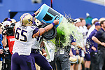Washington Huskies head coach Chris Petersen gets a gatorade bath after winning the Zaxby's Heart of Dallas Bowl game between the Washington Huskies and the Southern Miss Golden Eagles at the Cotton Bowl Stadium in Dallas, Texas. Washington defeats Southern Miss 44 to 31.