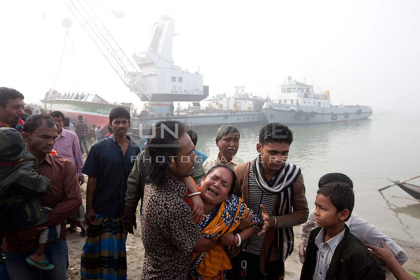 A Bangladeshi woman mourn her relatives after a river ferry carrying more than 100 capsized in the River Padma Sunday after being hit by a cargo vessel at Paturia , in Manikganj district, about 80 kilometers northwest of Dhaka, Bangladesh. Feb. 23, 2015