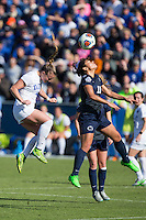 Cary, North Carolina - Sunday December 6, 2015: Raquel Rodriguez (11) of the Penn State Nittany Lions battles for a jump ball with Ashton Miller (4) of the Duke Blue Devils during first half action at the 2015 NCAA Women's College Cup at WakeMed Soccer Park.  The Nittany Lions defeated the Blue Devils 1-0.
