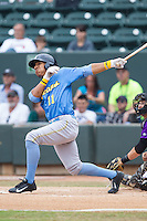 Christopher Bostick (11) of the Myrtle Beach Pelicans follows through on his swing against the Winston-Salem Dash at BB&T Ballpark on May 7, 2014 in Winston-Salem, North Carolina.  The Pelicans defeated the Dash 5-4 in 11 innings.  (Brian Westerholt/Four Seam Images)