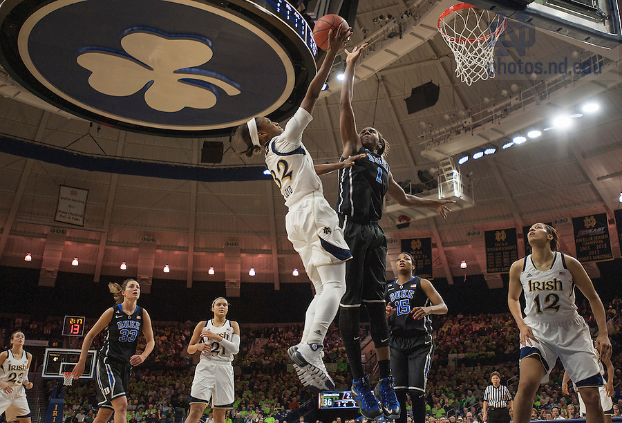Feb. 21, 2014; Guard Jewell Loyd shoots over Duke forward Elizabeth Williams during the first half. Notre Dame won 81 to 70. Photo by Barbara Johnston/University of Notre Dame