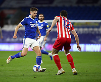 16th March 2021; Cardiff City Stadium, Cardiff, Glamorgan, Wales; English Football League Championship Football, Cardiff City versus Stoke City; Will Vaulks of Cardiff City passes the ball as he is pressured by James Chester of Stoke City