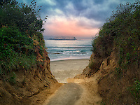 Path and sunrise at Devil's Punchbowl State Natural Area. Oregon