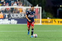 FOXBOROUGH, MA - JULY 7: Carles Gil #22 of New England Revolution looks to pass during a game between Toronto FC and New England Revolution at Gillette Stadium on July 7, 2021 in Foxborough, Massachusetts.