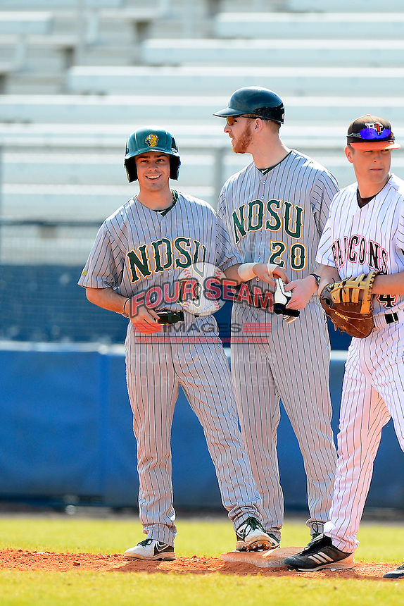 North Dakota State Bison second baseman Jon Hechtner (19) and coach Zach Wentz (20) during a game against the Bowling Green Falcons at Chain of Lakes Stadium on March 9, 2013 in Winter Haven, Florida.  NDSU defeated Bowling Green 8-5.  (Mike Janes/Four Seam Images)