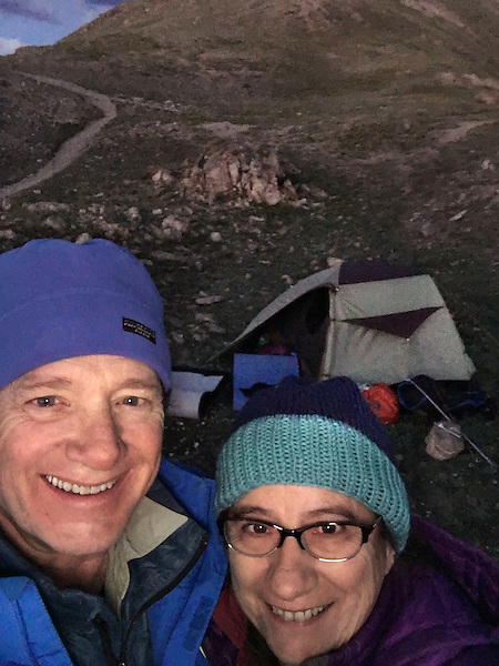 John and Beth camping atop Loveland Pass at sunset, Colorado