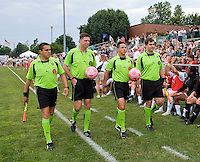 The referees prepare to take the field before a WPS match between the Sky Blue FC and the St. Louis Athletica at Anheuser-Busch Soccer Park, in St. Louis, MO, June 7, 2009. Athletica won the match 1-0.