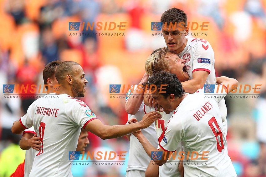AMSTERDAM, NETHERLANDS - JUNE 26: Kasper Dolberg of Denmark celebrates with team mates after scoring their side's first goal during the UEFA Euro 2020 Championship Round of 16 match between Wales and Denmark at Johan Cruijff Arena on June 26, 2021 in Amsterdam, Netherlands. (Photo by Christopher Lee - UEFA/UEFA via Getty Images)<br /> Photo Uefa/Insidefoto ITA ONLY