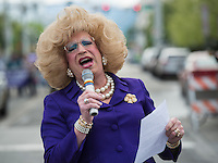 Legendary local drag queen and Mad Myrna's maintenance man Daphne DoAll LaChores MC's the Alaska PrideFest's Equality Parade as LGBT community members and supporters make their way through the streets of downtown Anchorage.