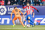 Yannick Ferreira Carrasco (r) of Atletico de Madrid competes for the ball with Ruben Pena Jimenez of SD Eibar during their Copa del Rey 2016-17 Quarter-final match between Atletico de Madrid and SD Eibar at the Vicente Calderón Stadium on 19 January 2017 in Madrid, Spain. Photo by Diego Gonzalez Souto / Power Sport Images