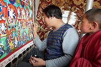 Painting thangka (traditional Tibetan painting) in the Upper Wutan Monastery, Rebgong (Chinese name - Tongren),  on the Qinghai-Tibetan Plateau. China.