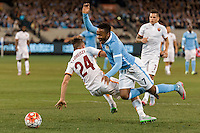 Melbourne, 21 July 2015 - Alessandro Florenzi of AS Roma and Raheem Sterling of Manchester City collide in game two of the International Champions Cup match at the Melbourne Cricket Ground, Australia. City def Roma 5-4 in Penalties. (Photo Sydney Low / AsteriskImages.com)
