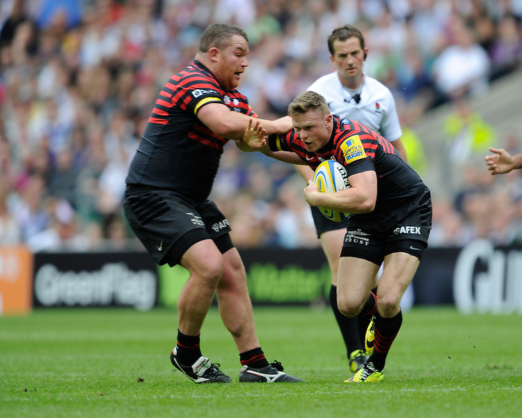 Chris Ashton of Saracens appears to run into team mate Matt Stevens of Saracens during the Aviva Premiership Final between Saracens and Northampton Saints at Twickenham Stadium on Saturday 31st May 2014 (Photo by Rob Munro)
