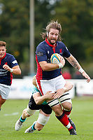 Alex Toolis of London Scottish is tackled during the Championship Cup match between London Scottish Football Club and Nottingham Rugby at Richmond Athletic Ground, Richmond, United Kingdom on 28 September 2019. Photo by Carlton Myrie / PRiME Media Images