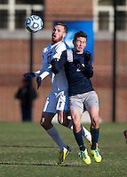 Bakie Goodman (20) of Georgetown goes up for a header with Ivan Militar (7) of Old Dominion during the second round of the NCAA tournament at Shaw Field in Washington, DC. Georgeotown defeated Old Dominion, 3-0.