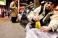 "Ronaldo, a self described ""freegan"", finds some discarded bananas outisde of a supermarket in New York City on April 5, 2006."
