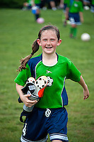 Proud young female soccer player after a winning game.