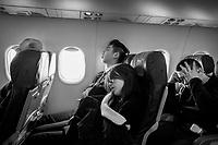 Germany. Baden-Württemberg State. Aslan and european passengers asleep on Eurowings flight to Stuttgart. 2.02.2020  © 2020 Didier Ruef