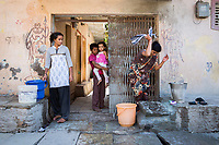 A woman washes her family's clothes outside her home in a district of Latur. As a result of the very limited supplies of water, people have been forced to change their daily routines, often reducing the numbers of times they wash their clothes each week.