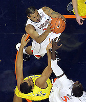 CHARLOTTESVILLE, VA- NOVEMBER 29: Mike Scott #23 of the Virginia Cavaliers grabs a rebound during the game on November 29, 2011 at the John Paul Jones Arena in Charlottesville, Virginia. Virginia defeated Michigan 70-58. (Photo by Andrew Shurtleff/Getty Images) *** Local Caption *** Mike Scott
