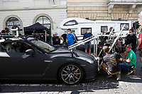 The coupe trying to fix a camera after a car crash occurred on the set of the film Mission Impossible 7 shot in Via Nazionale. The stuntman car and the camera car had a crash while shooting<br /> Rome (Italy), October 9th 2020<br /> Photo Samantha Zucchi Insidefoto