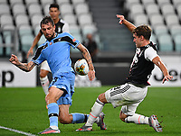 Calcio, Serie A: Juventus - Lazio, Allianz Stadium, July 20, 2020.<br /> Juventus' Mattnjs De Ligt  (l) in action with Lazio's Francesco Acerbi (r) during the Italian Serie A football match between Juventus and Lazio at the Allianz stadium in Turin, July 20, 2020.<br /> UPDATE IMAGES PRESS/Isabella Bonotto