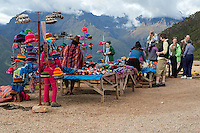 Peru, Urubamba Valley.  Tourists at Roadside Souvenir Stand.