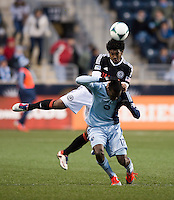 C.J. Sapong (17) of Sporting Kansas City has the ball headed away from him by Sheanon Williams (25) of Philadelphia Union during the game at PPL Park in Chester, PA.  Kansas City defeated Philadelphia, 3-1.