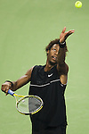 SHANGHAI, CHINA - OCTOBER 13:  Gael Monfils of France serves to his compatriot Paul-Henri Mathieu during day three of 2009 Shanghai ATP Masters 1000 at the Qi Zhong Tennis Centre in Shanghai.  Photo by Victor Fraile / The Power of Sport Images