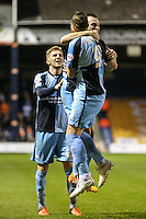 Paul Hayes of Wycombe Wanderers (right) celebrates scoring his team's second goal to make it 0-2 with Garry Thompson of Wycombe Wanderers (centre) during the Sky Bet League 2 match between Luton Town and Wycombe Wanderers at Kenilworth Road, Luton, England on 26 December 2015. Photo by David Horn.