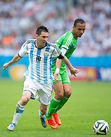 Lionel Messi of Argentina and Peter Odemwingie of Nigeria