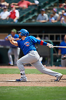 Iowa Cubs catcher Ali Solis (4) follows through on a swing during a game against the Memphis Redbirds on May 29, 2017 at AutoZone Park in Memphis, Tennessee.  Memphis defeated Iowa 6-5.  (Mike Janes/Four Seam Images)