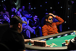 Yunus Jamal agonizes making a call of a bet by Sam Stain.  He eventually folded.
