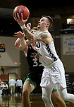 SIOUX FALLS, SD - MARCH 7: Carlos Jurgens #11 of the Oral Roberts Golden Eagles lays the ball up past Mitchell Sueker #35 of the North Dakota Fighting Hawks during the Summit League Basketball Tournament at the Sanford Pentagon in Sioux Falls, SD. (Photo by Dave Eggen/Inertia)