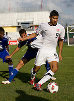 Mario Rodriguez (9) of the United States keeps the ball in the corner and away from Emmanual Labrada (3) of Cuba during the first day of the group stage at the CONCACAF Men's Under 17 Championship at Catherine Hall Stadium in Montego Bay, Jamaica. The United States defeated Cuba, 3-1.