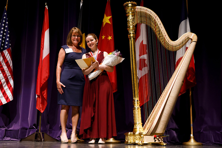 The Lyon and Healy CEO Janet Harrell presents first prize winner Melanie Laurent with a Concert Grand Harp during the awards ceremony of the 11th USA International Harp Competition at Indiana University in Bloomington, Indiana on Saturday, July 13, 2019. (Photo by James Brosher)