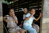 DOMINICAN REPUBLIC<br /> Children in the crowded riverside barrio of Capotillo, Santo Domingo, where houses have no running water or sanitation