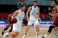 GRONINGEN - Basketbal , Open Dag met Donar - Antwerp Giants , voorbereiding seizoen 2021-2022, 05-09-2021,  Donar speler Austin Luke  in duel met Camron Krutwig