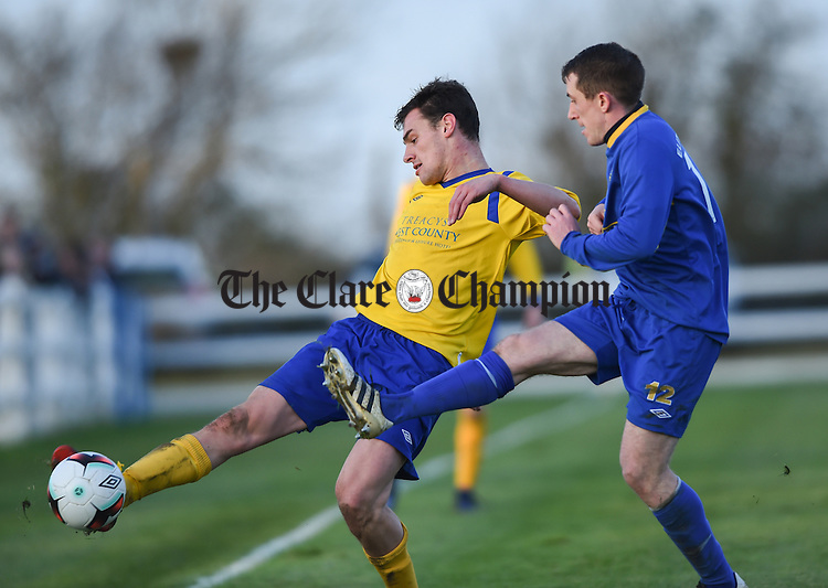 Niall Whelan of  Clare  in action against Gary Canavan of Roscommon during their Oscar Traynor game in Frank Healy park, Doora. Photograph by John Kelly.