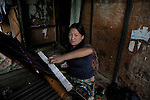 A lady weaving a Bhutanese dress material, this will be used to prepare their national dress gho (for men)and Kira(for ladies) . Arindam Mukherjee..