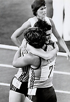 1982 FILE PHOTO - ARCHIVES -<br /> <br /> Edmonton. Aug 10th. Tears of joy. Judith Peckham (15) of Australia was so happy when she won the 800 metres final she fell into the arms of teammate Bev Frances (7) who ran over from the Javelin event she was in the congratulate Judith. The time was<br /> <br /> 1982<br /> <br /> PHOTO : Graham Bezant - Toronto Star Archives - AQP