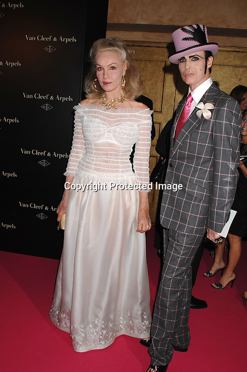 """Julie Newmar and Patrick McDonald..arriving at The Van Cleef & Arpels """"Une Journee a Paris"""" ..party to celebrate Fashion Week on September 4, 2007 at The Hammerstein Ballroom in New York. ..Photo by Robin Platzer, Twin Images....212-935-0770"""
