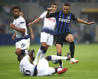 Football Soccer: UEFA Champions League FC Internazionale Milano vs Tottenham Hotspur FC, Giuseppe Meazza stadium, September 15, 2018.<br /> Inter's Matias Vecino (r) in action with Tottenham's Mousa Dembélé (l) and Davinson Sanchez (c) during the Uefa Champions League football match between Internazionale Milano and Tottenham Hotspur at Giuseppe Meazza (San Siro) stadium, September 18, 2018.<br /> UPDATE IMAGES PRESS/Isabella Bonotto
