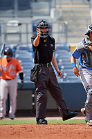 Home plate umpire Nathan Diederich calls a strike during a Florida Instructional League game between the Baltimore Orioles and the Tampa Bay Rays on October 1, 2018 at the Charlotte Sports Park in Port Charlotte, Florida.  (Mike Janes/Four Seam Images)