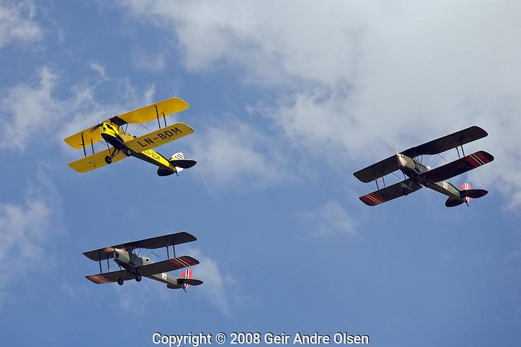 Three Bucker Jungman biplanes flying in formation above Kjeller Airport in Norway