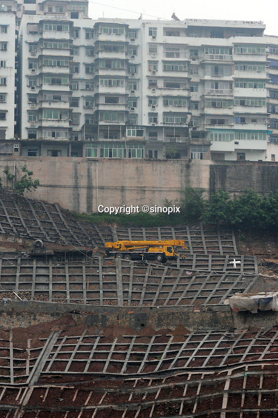 Blocks of flats condemned for destruction at Fengie on the Three Gorges Dam.  Several of the new cities are suffering from structural damage due to land and earth movements caused by the 400 kmThree Gorges reservoir.<br /> <br /> PHOTO BY RICHARD JONES-SINOPIX